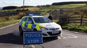 Police at the scene of the crash involving a cyclist on the Glenside Road in Dunmurry