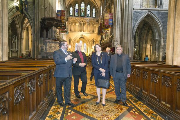 Mrs Foster with curator Louis Parminter, Archbishop of Dublin Michael Jackson, and Dean William Morton inside the cathedral