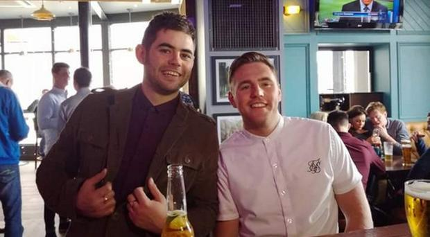 Dean McIlwaine (left), whose body was found on Cave Hill in July 2017, with brother Glenn