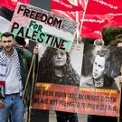 People protest outside Queen's University, Belfast, during the visit of Israeli ambassador to the UK Mark Regev (Liam McBurney/PA)