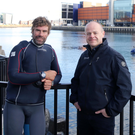 British double Olympic Gold yachtsman Iain Percy OBE, left, with Mark Gillan from Artemis Technologies at Belfast Harbour.