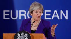 Prime Minister Theresa May speaks to the media following the EU summit in Brussels yesterday