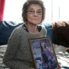 Gina Murray with a photo of Leanne, who was 13 when she was killed in the 1993 atrocity