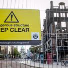 A cordon with a warning sign surrounds the historic five-storey Bank Buildings in Belfast city centre (Liam McBurney/PA