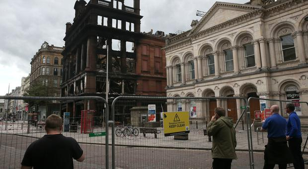 The safety cordon around the Bank Buildings has restricted a number of businesses from trading (Brian Lawless/PA)
