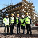 Richard Pengelly of the Department of Health (second left) and chair of Mid Ulster Council Sean McPeake with NIFRS's Michael Graham, Carmel McKinney and Gary Thompson at the Desertcreat centre