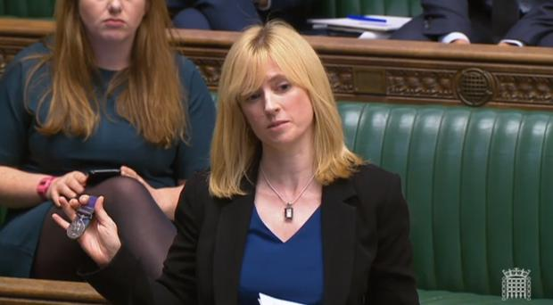 Labour's Rosie Duffield holds up a medal from one of her constituents in the Commons (PA)