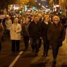 Members of the public take part in a memorial march in Belfast to mark the 25th anniversary of the Shankill Road bombing (Niall Carson/PA)