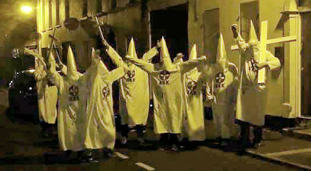 People dressed in Ku Klux Klan costumes outside a mosque in Newtownards