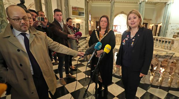 Lord Mayor of Belfast Deirdre Hargey, centre left, and Karen Bradley speak to the media at Belfast City Hall (Brian Lawless/PA)