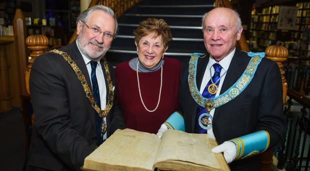 Olivia Nash with Most Worshipful Grand Master of Ireland Douglas Grey and Right Worshipful Provincial Grand Master of Antrim John Dickson at the Linen Hall Library