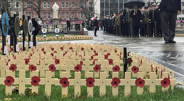 Crosses are laid at Belfast City Hall in memory of those killed in the First World War (Rebecca Black/PA)