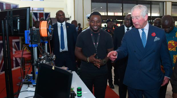 Prince Charles views a 3D printer during a Young Entrepreneurs Event at the International Conference Centre in Ghana