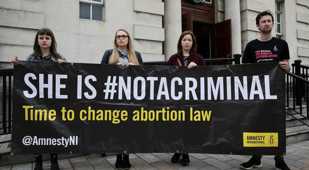Pro choice advocates outside the High Court in Belfast (Brian Lawless/PA)