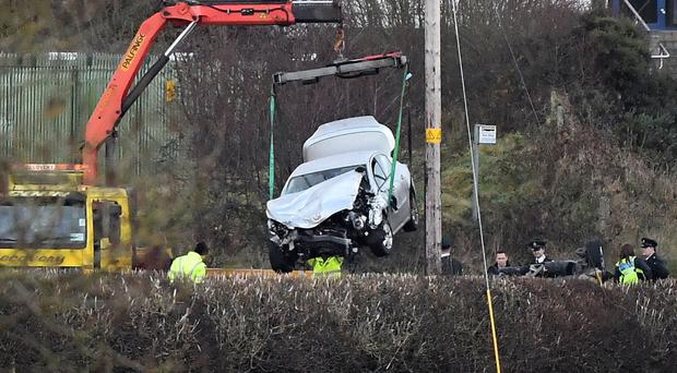 A car being removed from the crash scene near Omagh in which Maurice McCloughan and Killian Doherty were killed