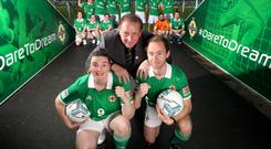 Ruth Boyle and Matthew Gallagher from Street Soccer NI teams alongside Gerry Armstrong at a farewell reception ahead of their trip to Mexico