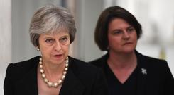 Theresa May depends on the votes of the 10 MPs from Arlene Foster's Democratic Unionist Party (Clodagh Kilcoyne/PA)