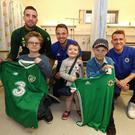 Northern Ireland's Steven Davis and Jonny Evans and Republic of Ireland's Shane Duffy with Tom Walsh, Sophie Walsh and Cathal Tobin