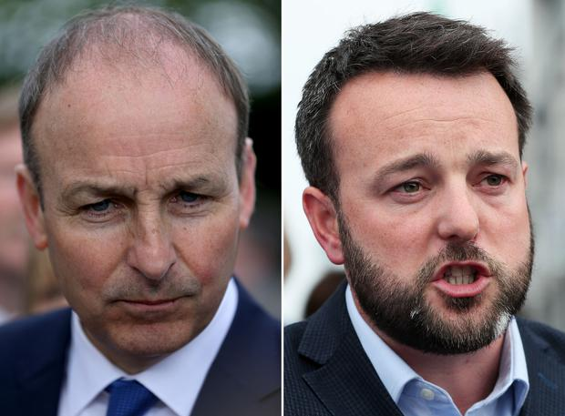 Fianna Fail leader Micheal Martin (left) and SDLP leader Colum Eastwood are engaged in talks about a potential electoral merger in Northern Ireland (PA)