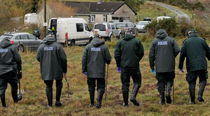 Officers search the area near Pauline Kilkenny's homes.