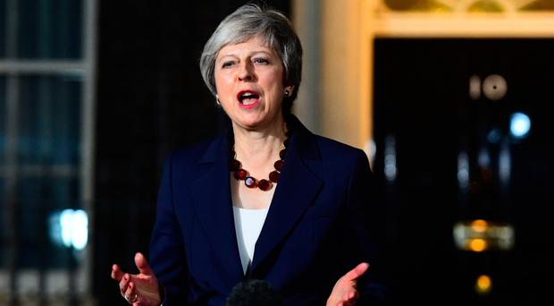 Prime Minister Theresa May makes a statement outside Number 10 last night