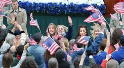 The stars of Derry Girls on set in the city yesterday, where they filmed scenes centred on US President Bill Clinton's visit in 1995