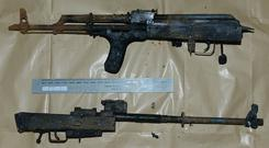 A weapons haul which was discovered in a residential boiler house that caught fire in Belfast (PSNI/PA)