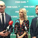 Simon Coveney with European Affairs Minister Helen McEntee and Fine Gael spokesman on EU Affairs Senator Neale Richmond (Cate McCurry/PA)
