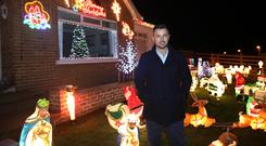 Gareth Watson has just finished decorating his Larne house with hundreds of Christmas lights and decorations