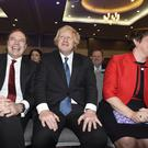 Boris Johnson, centre, sits with DUP leader Arlene Foster and her deputy Nigel Dodds at the party's annual conference in Belfast (Michael Cooper/PA)