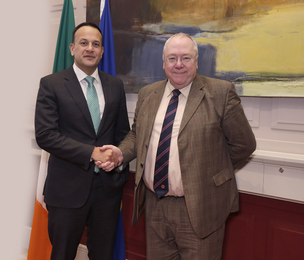 Taoiseach LeoVaradkar shakes hands with the Reverend Mervyn Gibson at Government Buildings in Dublin
