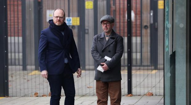 Journalists Barry McCaffrey (right) and Trevor Birney arrive at Musgrave police station in Belfast (Brian Lawless/PA)