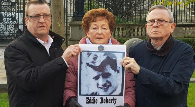 The family of Eddie Doherty, one of those killed in shootings in Ballymurphy in 1971, outside Belfast Coroner's Court (Rebecca Black/PA)
