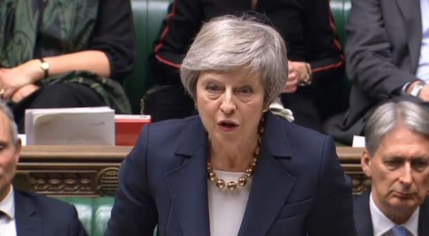 Prime Minister Theresa May faced three Commons defeats on the first day of debate on her Brexit plan (PA)