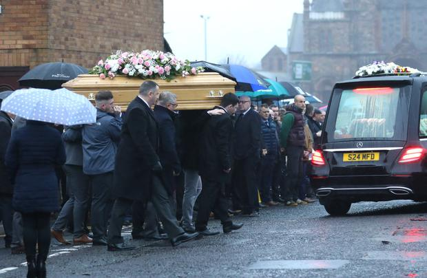 Mourners at the funeral of taxi driver Brian Braiden from the family home in Sackville Court in the lower Shankill