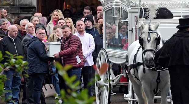 Family and friends helping to carry the coffin of Caoilte Fitzsimons from St Therese of Lisieux Church