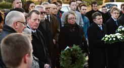 Anne Graham (centre) is joined by Lord Trimble and UUP leader Robin Swann for the act of remembrance on the 35th anniversary of her brother Edgar's murder yesterday