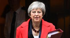 Prime Minister Theresa May leaves 10 Downing Street, London, for the House of Commons to face Prime Minister's Questions.