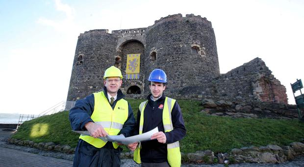 Dr John O'Keeffe from the Department for Communities and James McNicholl from JPM Contracts Ltd, which secured the contract to build the new roof