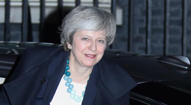 Prime Minister Theresa May arrives back at 10 Downing Street, London.