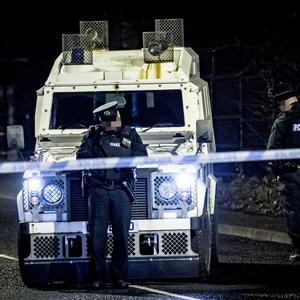 Police at the scene of a security alert on the Upper Dunmurry Lane in west Belfast
