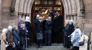 Family and friends carry the coffin of Teresa Keightley from Holy Trinity Church, Cookstown