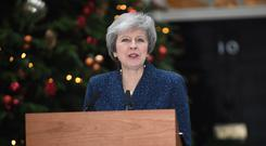 Prime Minister Theresa May makes a statement outside 10 Downing Street, London, after the 1922 Committee announced that enough Conservative MPs have requested a vote of confidence in Mrs May to trigger a leadership contest. (Stefan Rousseau/PA)
