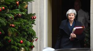 Prime Minister Theresa May leaves 10 Downing Street, London, for the House of Commons to face Prime Minister's Questions, after the 1922 Committee announced that Conservative MPs have requested a vote of confidence in Mrs May. (Kirsty O'Connor/PA)