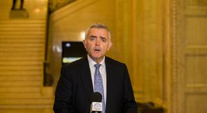 Jonathan Bell addressing the media at Parliament Buildings in Stormont