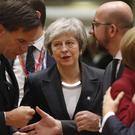Prime Minister Theresa May arrives for a round table meeting at an EU summit (Alastair Grant/AP)