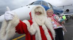Santa Claus with the children from Ardnashee School and College at City of Derry Airport