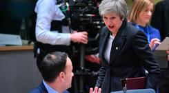 Prime Minister Theresa May reacts as she meets Taoiseach Leo Varadkar in Brussels yesterday