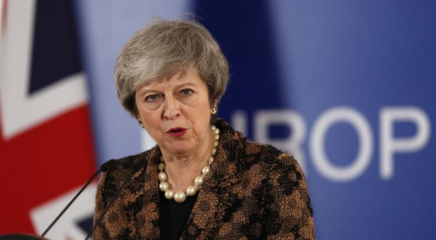 Prime Minister Theresa May speaks during a media conference at the EU summit in Brussels (Alastair Grant/AP)
