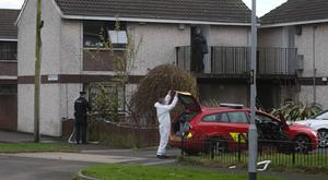 Police and forensic experts at the scene of the Antrim fire
